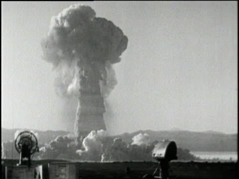 A mushroom cloud rises from an atomic bomb test site in Nevada