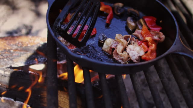 mushrooms and bell pepper cooking over campfire - cast iron stock videos & royalty-free footage