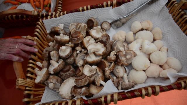 mushrooms in basket at a farmers market. - shiitake stock videos & royalty-free footage