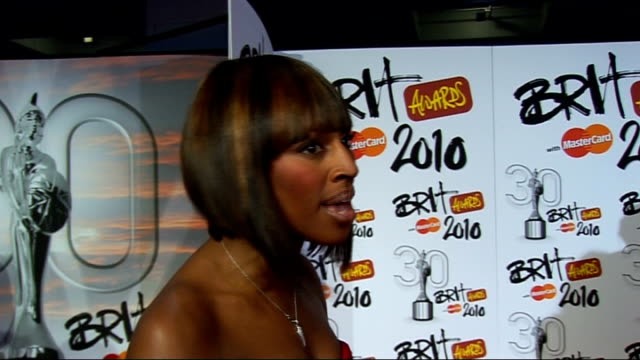 brit awards: red carpet arrivals; alexandra burke interview sot - her outfit / her nomination and competition / performances / memories of the brits... - popular music tour stock videos & royalty-free footage
