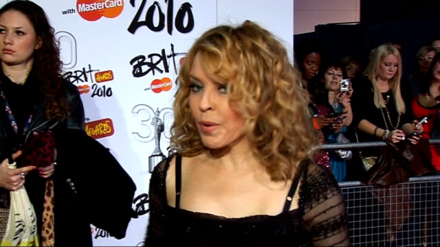 brit awards: red carpet arrivals; kylie minogue interview sot - on her outfit by d & g / robbie williams / memories of the brits / becoming an aunt... - dolce & gabbana stock videos & royalty-free footage