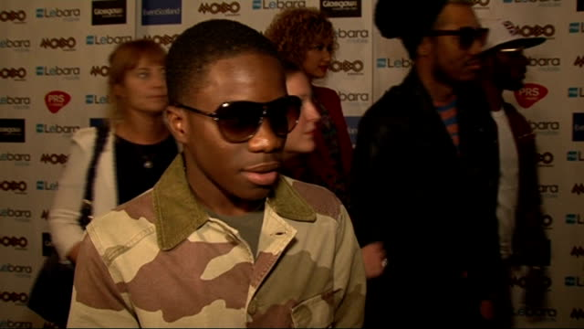 "awards nominations: celebrity interviews; tinchy stryder interview sot - on how it feels good to be at the mobos / on which artists he's supporting ""... - ポピュラーミュージックツアー点の映像素材/bロール"