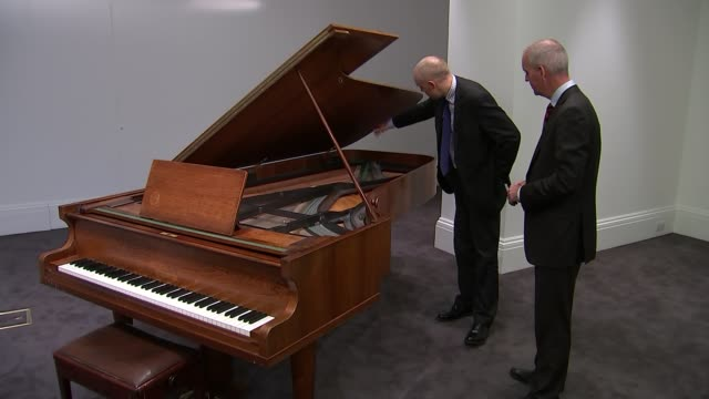 Abba piano to be auctioned Philip Errington interview SOT Hand pointing at piano interior