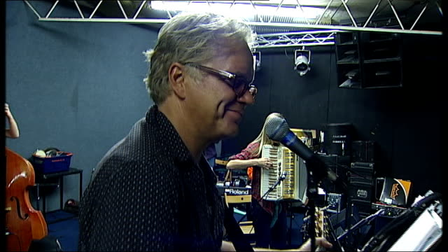 Actor Tim Robbins to tour with folk band Band rehearsing with Robbins singing at microphone SOT