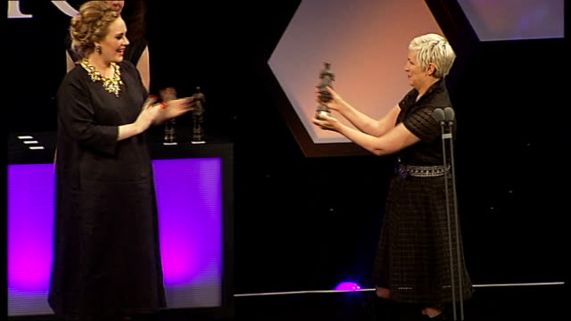adele wins two ivor novello awards adele onto stage to win the ivor novello award for songwriter of the year adele wiping away tears annie lennox... - award stock videos & royalty-free footage