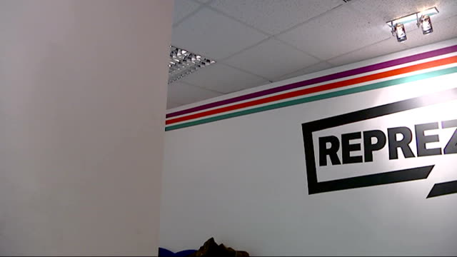 afrikan boy to tour europe sudan and ethiopia peckham reprezent sign on wall of reprezent radio station pan reporter into room dj neptizzle sat... - popular music tour stock videos and b-roll footage