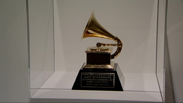 amy winehouse exhibition at london's jewish museum; jewish museum london: int grammy award on display in glass cabinet - grammy awards stock-videos und b-roll-filmmaterial