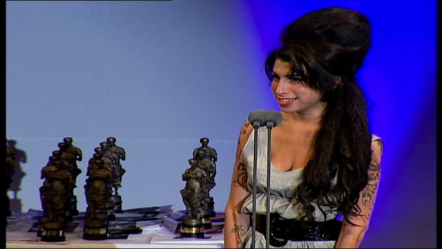 amy winehouse hospitalised; winehouse acceptance speech for ivor novello award sot - thank you very much, i didn't even have time to get drunk, i've... - amy winehouse stock-videos und b-roll-filmmaterial