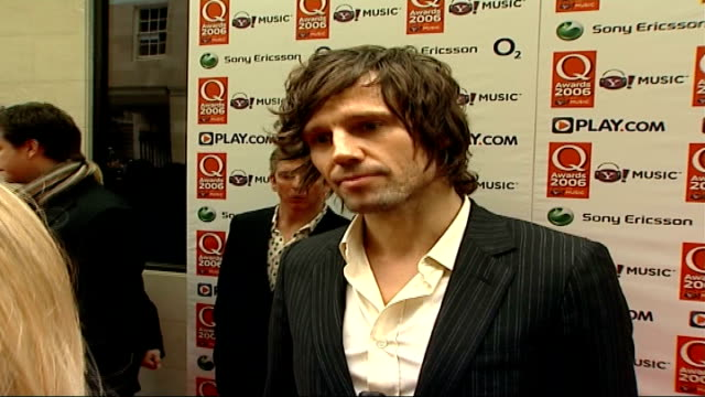red carpet arrivals jason orange interview sot talks about take that being back together / its weird / glad we did it / one down without rob / miss... - take that stock videos and b-roll footage