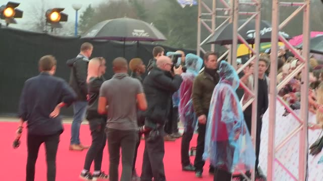 music awards red carpet interviews; england: london: int **beware flash photography** one direction pose for photos ext one direction sign autographs... - boy band stock videos & royalty-free footage