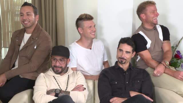 Backstreet Boys interview ENGLAND London INT Backstreet Boys interview SOT On Premier League football predictions / singing part of their song 'Don't...