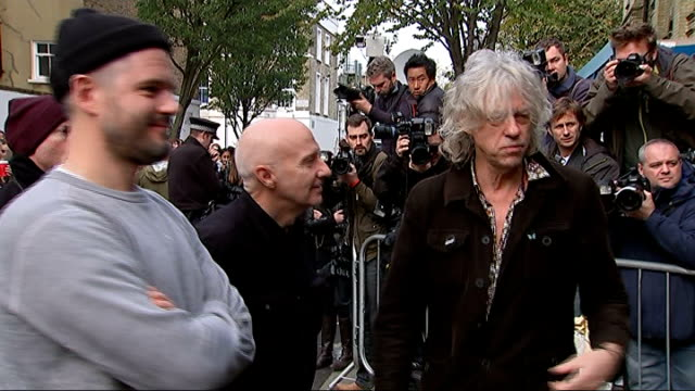 band aid 30 arrivals and interviews gvs olly murs arriving / gvs bob geldof and midge ure standing for photo op together outside / midge ure sot /... - bob geldof stock videos & royalty-free footage