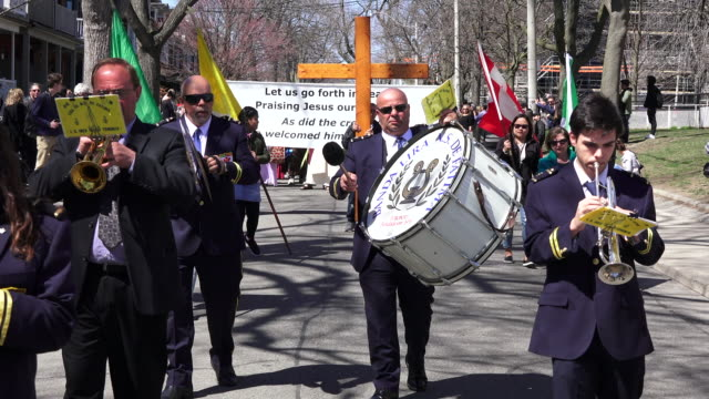 music band leading the christian procession in the streets of toronto during holy week - holy week stock videos & royalty-free footage
