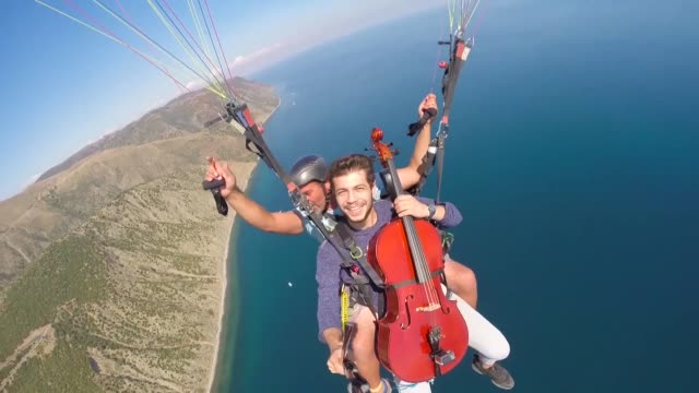A music band named Techniclassical consists of students of Yildiz Technical University shoot a video for their song 'Geri Sayim' by paragliding in...