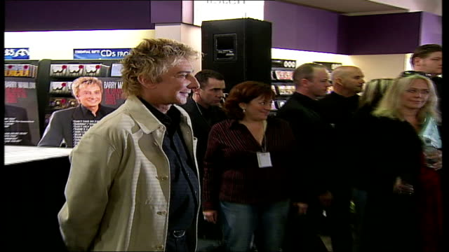 barry manilow album signing at hmv oxford street; manilow posing for photocall manilow fans screaming and taking pictures as queue up to meet manilow... - barry manilow stock videos & royalty-free footage