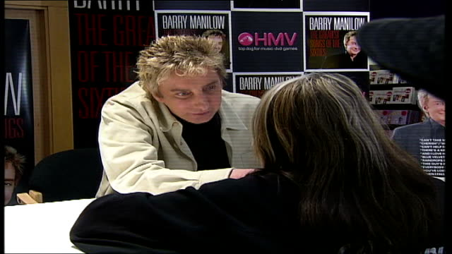 vídeos de stock, filmes e b-roll de barry manilow album signing at hmv oxford street **manilow interview partly overlaid sot** manilow talking to female fan woman's hands holding... - título de álbum