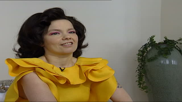 bjork interview; england: london: int bjork interview sot part 2 of 4. - talks of making charity album for unicef which features various cover... - björk stock videos & royalty-free footage