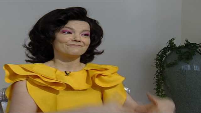 bjork interview; england: london: int bjork interview sot part 3 of 4. - talks of making charity album for unicef which features various cover... - björk stock videos & royalty-free footage