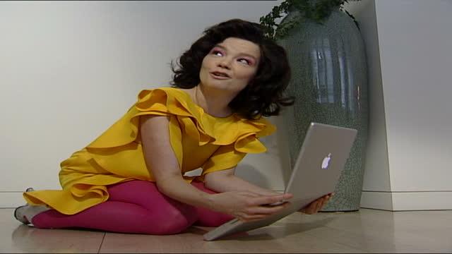 bjork interview; england: london: int bjork interview sot part 4 of 4. gvs bjork kneeling on the floor using laptop computer - björk stock videos & royalty-free footage