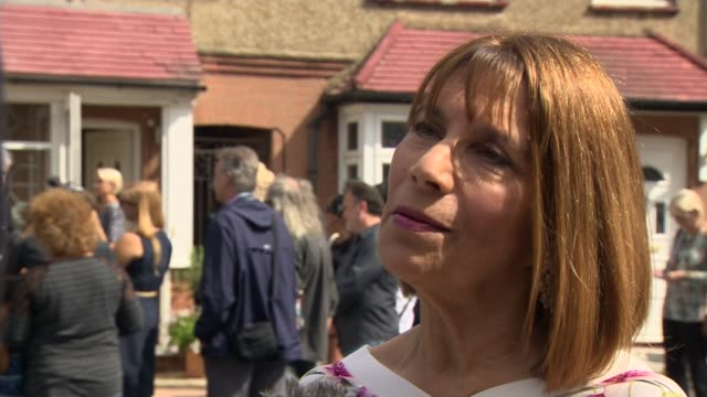 Blue plaque unveiled at Freddie Mercury's childhood home Kashmira Cooke interview SOT Ray Edwards along with daughter Daria and reporter Daria...