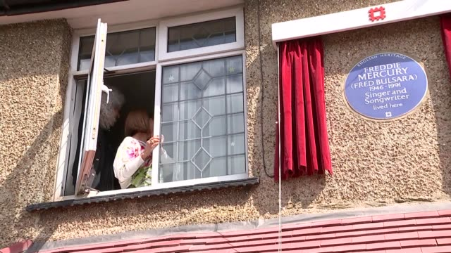 Blue plaque unveiled at Freddie Mercury's childhood home EXT Brian May and Kashmira Cooke looking out window