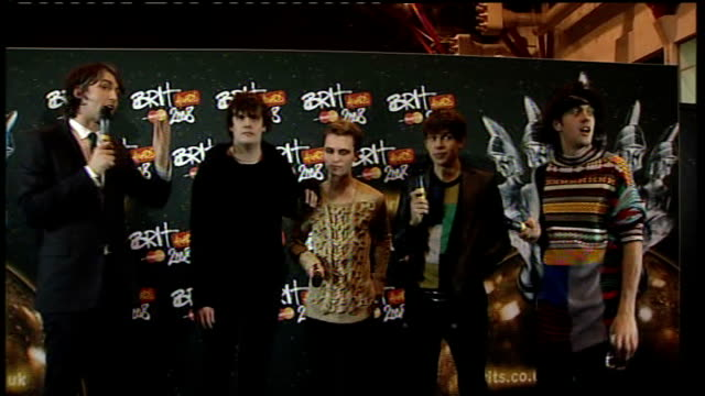 brit awards 2008 interviews with brit award winners klaxons pop band interview sot talk about their performance with rhianna on stage at the brit... - ブリット・アワード点の映像素材/bロール