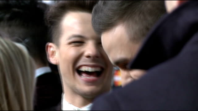 Brit Awards 2013 Arrivals and interviews More of One Direction on the red carpet / Harry Styles chatting to man on red carpet / Niall Horan Harry...
