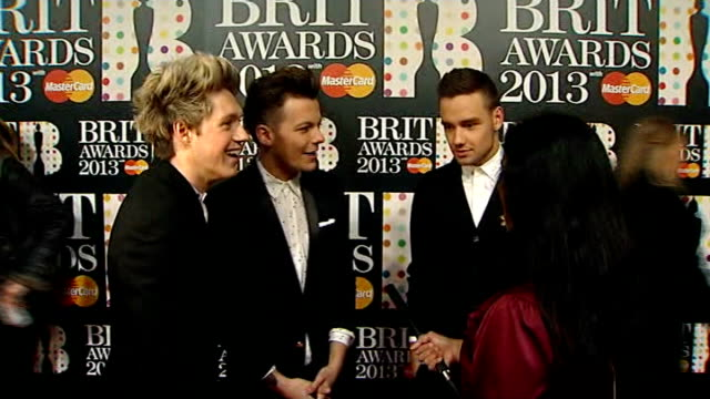 brit awards 2013 int boy band one direction being interviewed louis tomlinson liam payne interview sot we blagged it / thank fans it's a bit mad... - boy band stock videos & royalty-free footage
