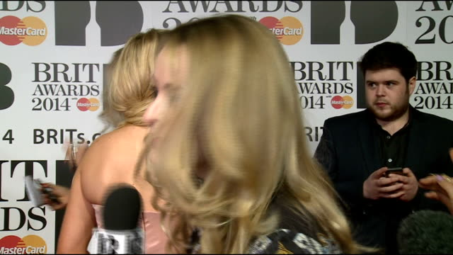 brit awards 2014 red carpet arrivals england london greenwich o2 arena int gvs ellie goulding talking to press / neon jungle talking to press neon... - milliner stock videos and b-roll footage