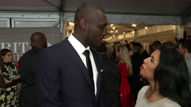 brit awards 2017 red carpet interviews music brit awards 2017 red carpet interviews christine and the queens interview sot stormzy interview sot re... - stormzy stock videos and b-roll footage