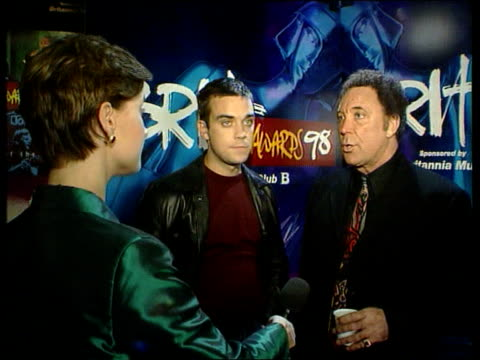 london: docklands: london arena: tom jones intvw sot - if you're voted for you should take it as honour robbie williams intvw sot - if you melt... - london docklands stock videos & royalty-free footage