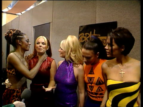 vídeos de stock e filmes b-roll de brit awards itn england london docklands london arena the spice girls mel b mel c victoria adams as geri halliwell intvw sot its honour/ we've been... - spice girls