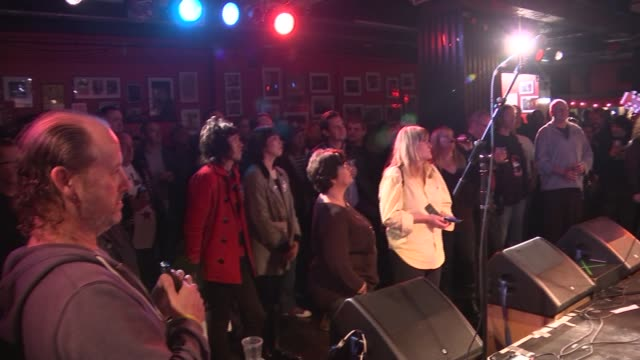 campaign to save music venues in london england london int various shots musician playing guitar and singing on stage at small venue with people... - plucking an instrument stock videos and b-roll footage