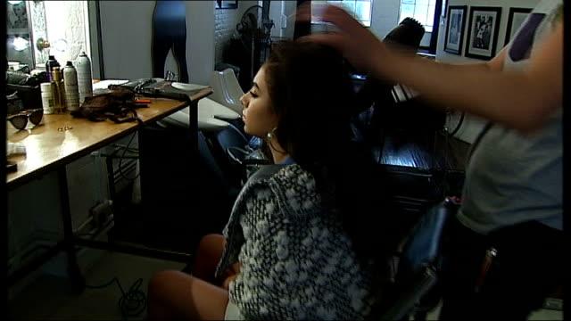 charli xcx charli xcx interview sot charli xcx having hair stylerd by hairdresser - charli xcx stock videos & royalty-free footage