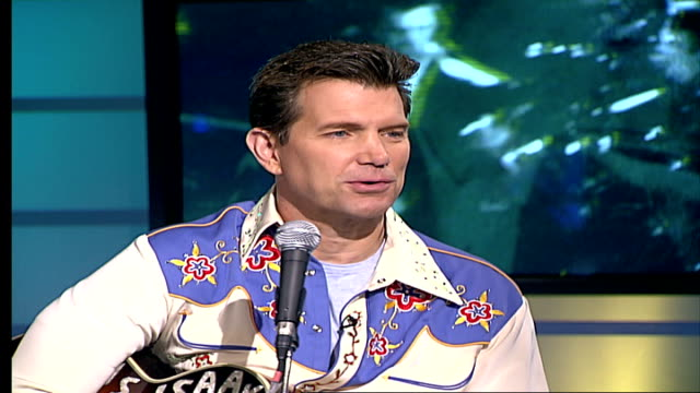 vídeos de stock, filmes e b-roll de chris isaak releases 'greatest hits' album england london gir int chris isaak live studio interview as sits with kenny johnson sot they were... - chris isaak