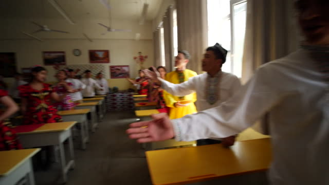 music class at secure reeducation facility for muslim ethnic groups in xinjiang promoted by china as a school to combat islamist extremism - xinjiang province stock videos & royalty-free footage
