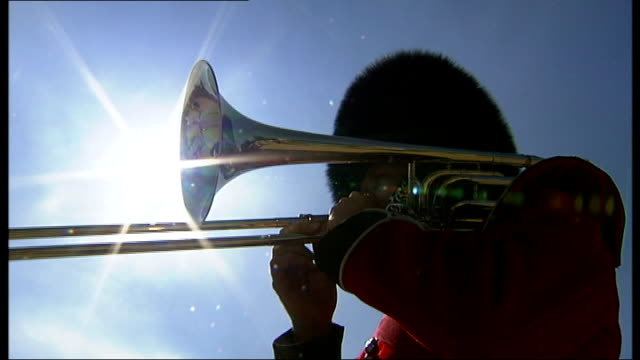 coldstream guards band sign record deal various of band member playing trombone to tune of 'hey jude' sot / trombonist playing more formal song sot - trombone stock videos & royalty-free footage