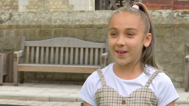hundreds of london schoolchildren take part in online choir; england: london: tower of london: ext vox pops - members of water city music children's... - primary school child stock videos & royalty-free footage