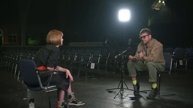 damon albarn interview; england: manchester: manchester central convention complex: int wide shot stage technicians on stage damon albarn 2-shot with... - tilt up stock videos & royalty-free footage