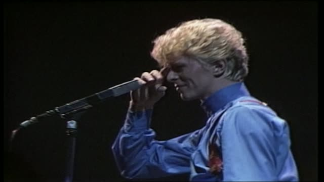 stockvideo's en b-roll-footage met david bowie dies aged 69 as300683015 / london hammersmith int **music heard sot** various of david bowie performing on stage - david bowie
