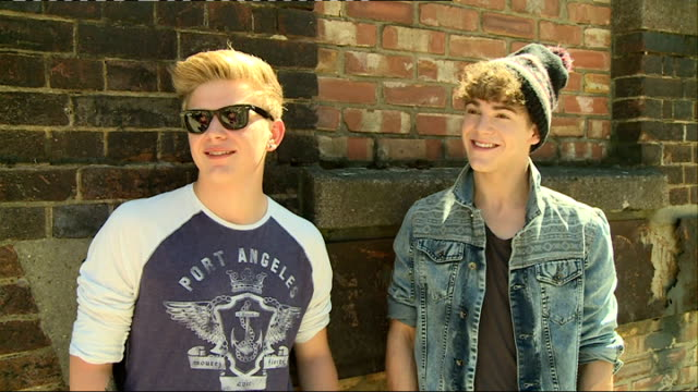 district3 announce debut ep: district3 interview; england: london: ext district3 interview sot - what life has been like a year after the x factor -... - hair band stock videos & royalty-free footage