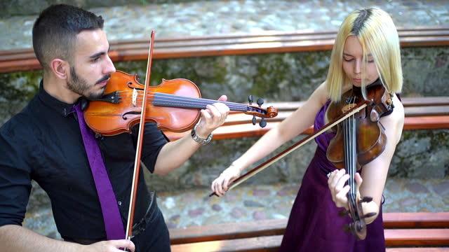 music duo group performing violin - violin stock videos & royalty-free footage
