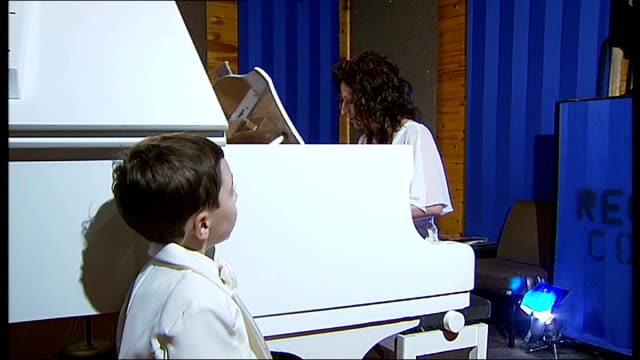 four-year-old becomes youngest person in britain to pass grade one piano exam; england: london: mill hill: int hayley elton playing piano sot curtis... - stool stock videos & royalty-free footage
