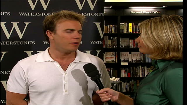 gary barlow book signing at waterstones **take that song 'it only takes a minute' partly overlaid sot** barlow interview with reporter in shot sot if... - boy band stock videos & royalty-free footage