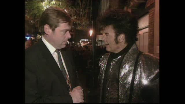 gary glitter switches on christmas lights in london; england: london: studio:intlive reporter introduction sotwest end:ext / nightreporter ptc with... - gary glitter stock videos & royalty-free footage