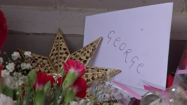 george michael dies aged 53; england: oxfordshire: goring-on-thames: ext various shots mourners and floral tributes outside george michael's house - oxfordshire stock videos & royalty-free footage