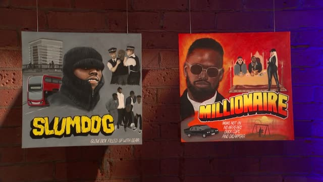 ghetts interview england london ghetts album covers 'slumdog' and 'millionaire' on display - アルバムのタイトル点の映像素材/bロール