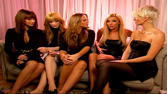 girls aloud battle for christmas number one with the spice girls; england: london: int girls aloud interview sot - talks about new album and single - spice girls stock-videos und b-roll-filmmaterial