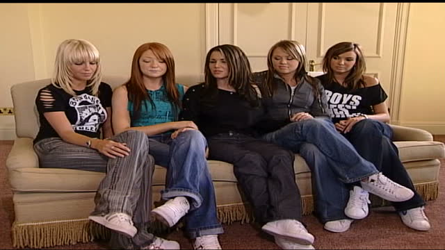 'girls aloud' interview; england: london: int from left to right members of band 'girls aloud' sat on sofa: sarah harding; nicola roberts; cheryl... - an answer film title stock videos & royalty-free footage
