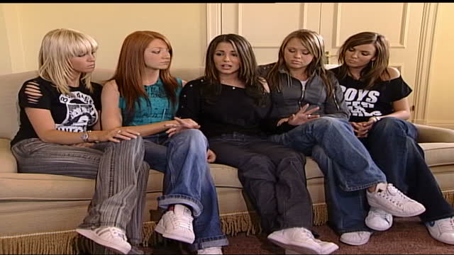 'girls aloud' interview; england: london: int from left to right members of band 'girls aloud' sat on sofa: sarah harding; nicola roberts; cheryl... - talking stock videos & royalty-free footage